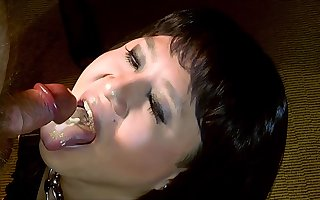 Dark-haired shemale enjoying some cum