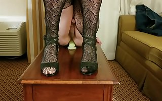 Crossdresser Cristy rides dildo on table